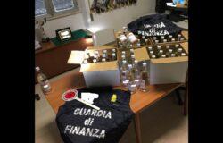 Guardia di Finanza, bottiglie, alcol puro, contrabbando
